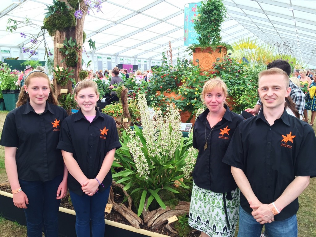 Bristol Aquarium's Wendy Desyllas and Matt Orlik, right, with students from Writhlington School and their orchid display at Hampton Court Flower Show